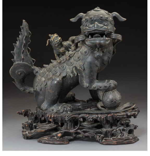 A Chinese Bronze Foo Lion Censer on Rosewood Stand, Qing Dynasty
