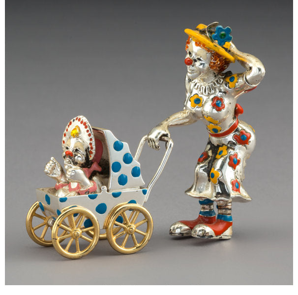 A Three Piece Tiffany & Co. Silver and Enamel Circus Clown Mother and Baby in Carriage