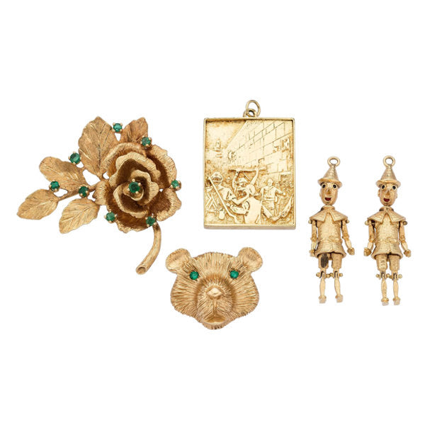 Emerald, Gold Brooches and Charms