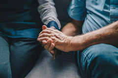 Couple with arthritis holding hands