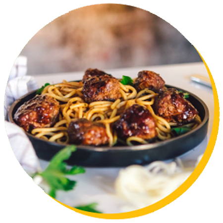 A picture of a plate of meatballs and spaghetti in a circle frame.
