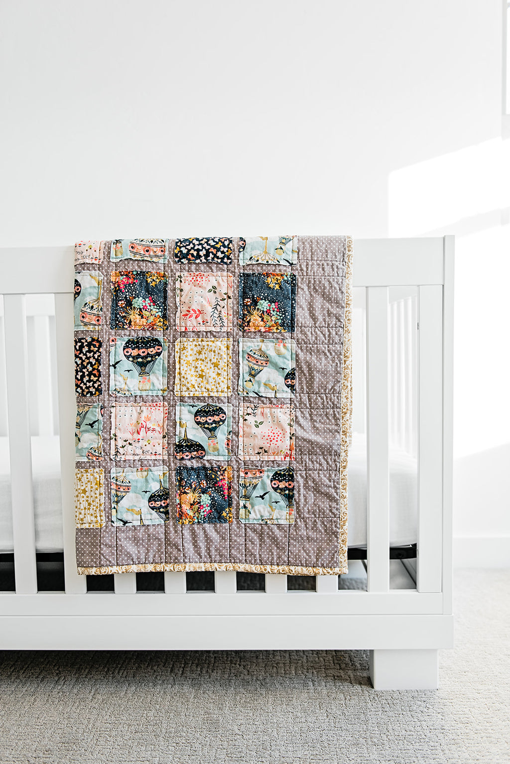 dreamy-whimsical-boho-quilt-for-modern-storybook-nursery