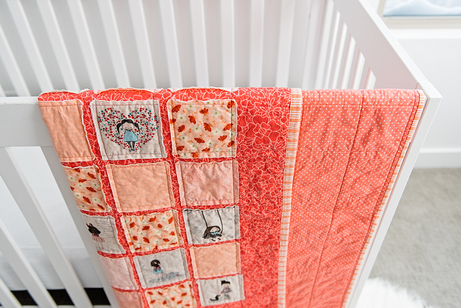 little-abbie-quilt-and-white-crib-bright-nursery