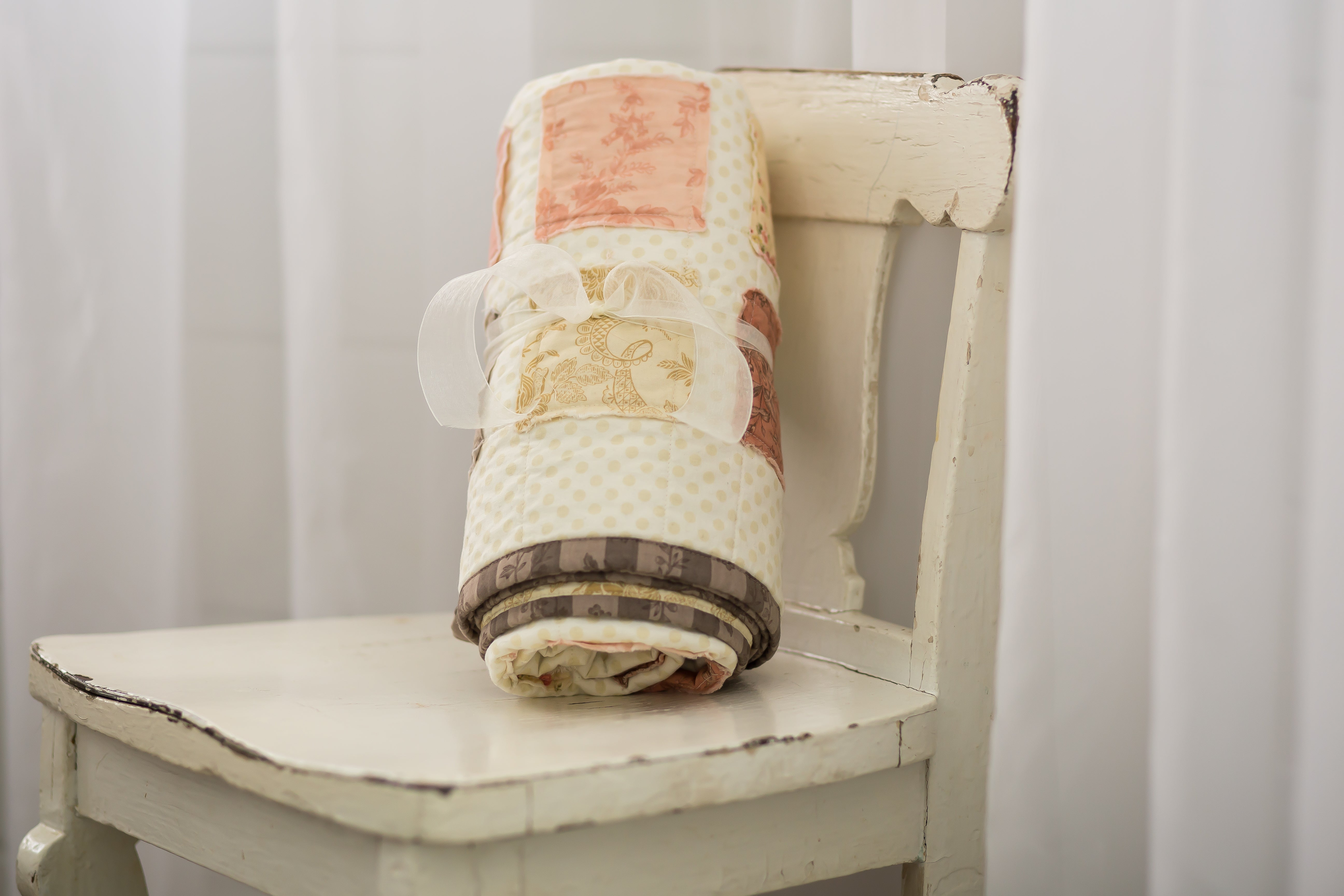 newborn-quilt-on-shabby-chic-chair-classic-baby-room-decor