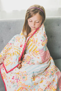 young-girl-brown-hair-wrapped-up-in-striped-floral-handmade-quilt-sugar-owl-design