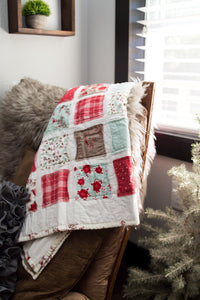 sugar-owl-designs-christmas-quilt-draped-over-a-living-chair