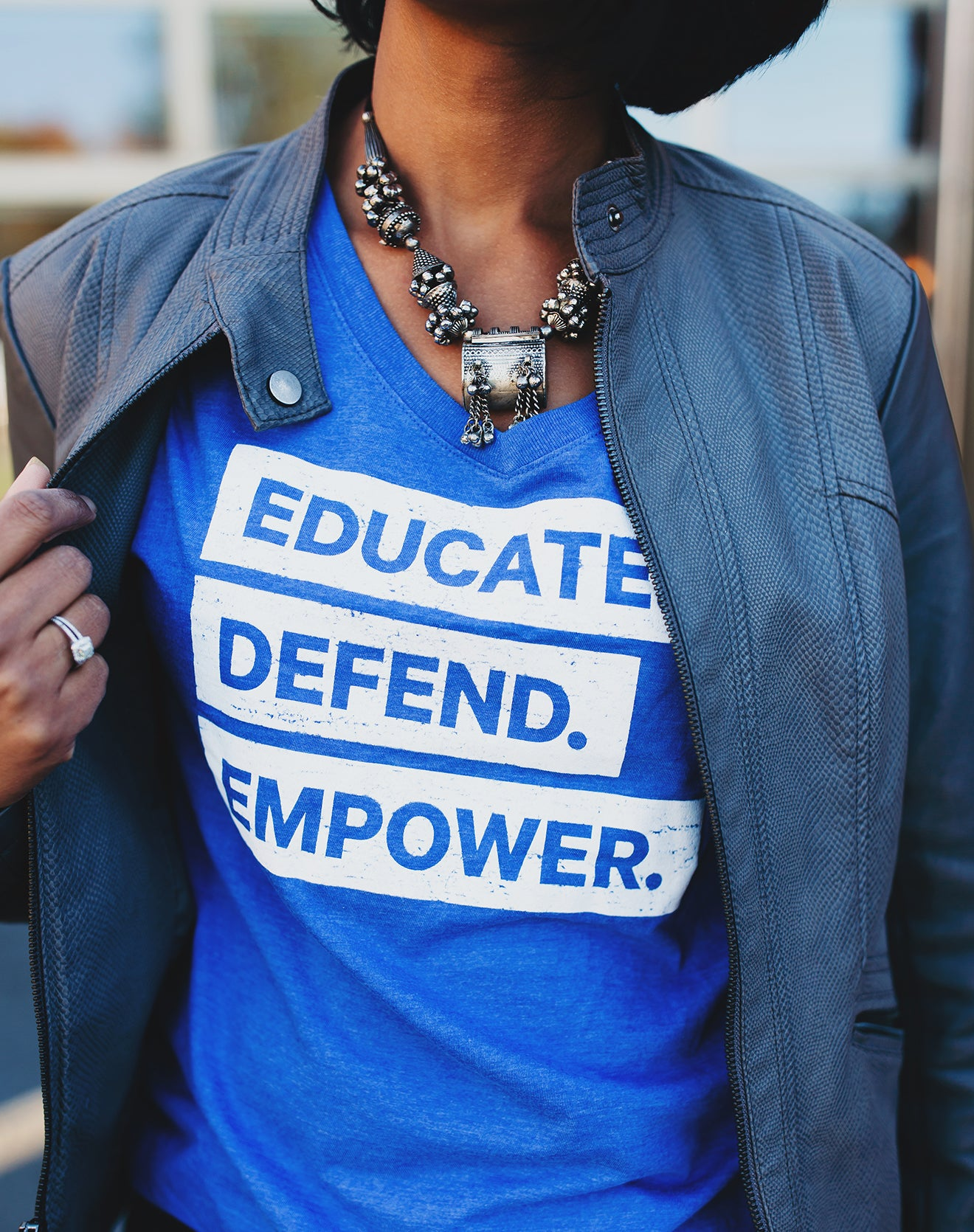 """Educate. Empower. Defend."" Blue V-Neck Short-Sleeved Tee"