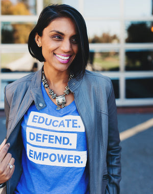 Defend Innocence Educate. Empower. Defend. Royal Blue V-Neck Tee