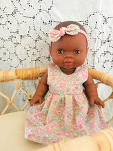 Doll with handmade Liberty dress and matching headband.
