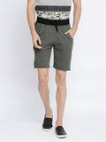 Green terry shorts with raw edge