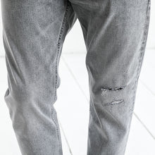 Load image into Gallery viewer, Ankle-Length Ripped Denim Trousers | Spring Summer 2018 - esstey