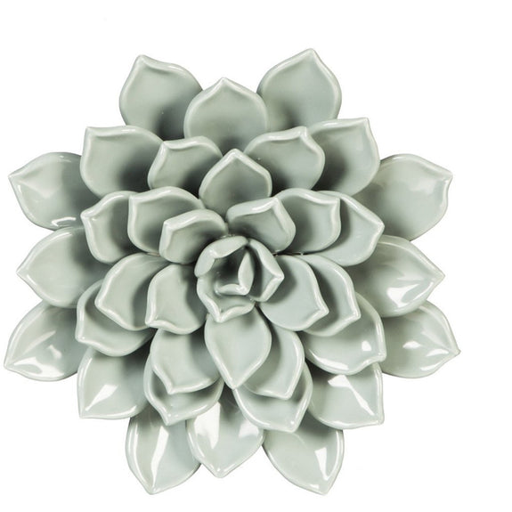 Hand-sculpted and glazed ceramic floral wall décor inspired by nature are the perfect garnish for dinner tables, shelves, and side tables. Back keyhole design allows you to easily hang on any wall or ceiling to create an #insta-worthy, one-of-a-kind art installation.  Due to the handcrafted nature of this item, expect slight variation in the appearance of each unique piece.