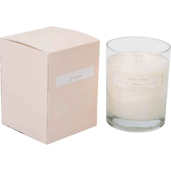Sparkling citrus elegantly blends with petal-soft lilies, crisp cedar wood, and seductive musk.  A pretty colored box slides out of a matching paper sleeve that reveals a complementary hidden pattern and a simple glass candle.  Measures approximately 3.5 x 4.5 inches. Candle scent burns for approximately 55 hours.