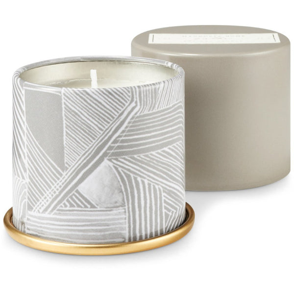 Crisp bergamot, plum, and sweet jasmine effortlessly mingle with tonka, dark amber, and warm sandalwood. Measures approximately 2.5 x 2.25 inches.  Candle burns for approximately 20 hours.