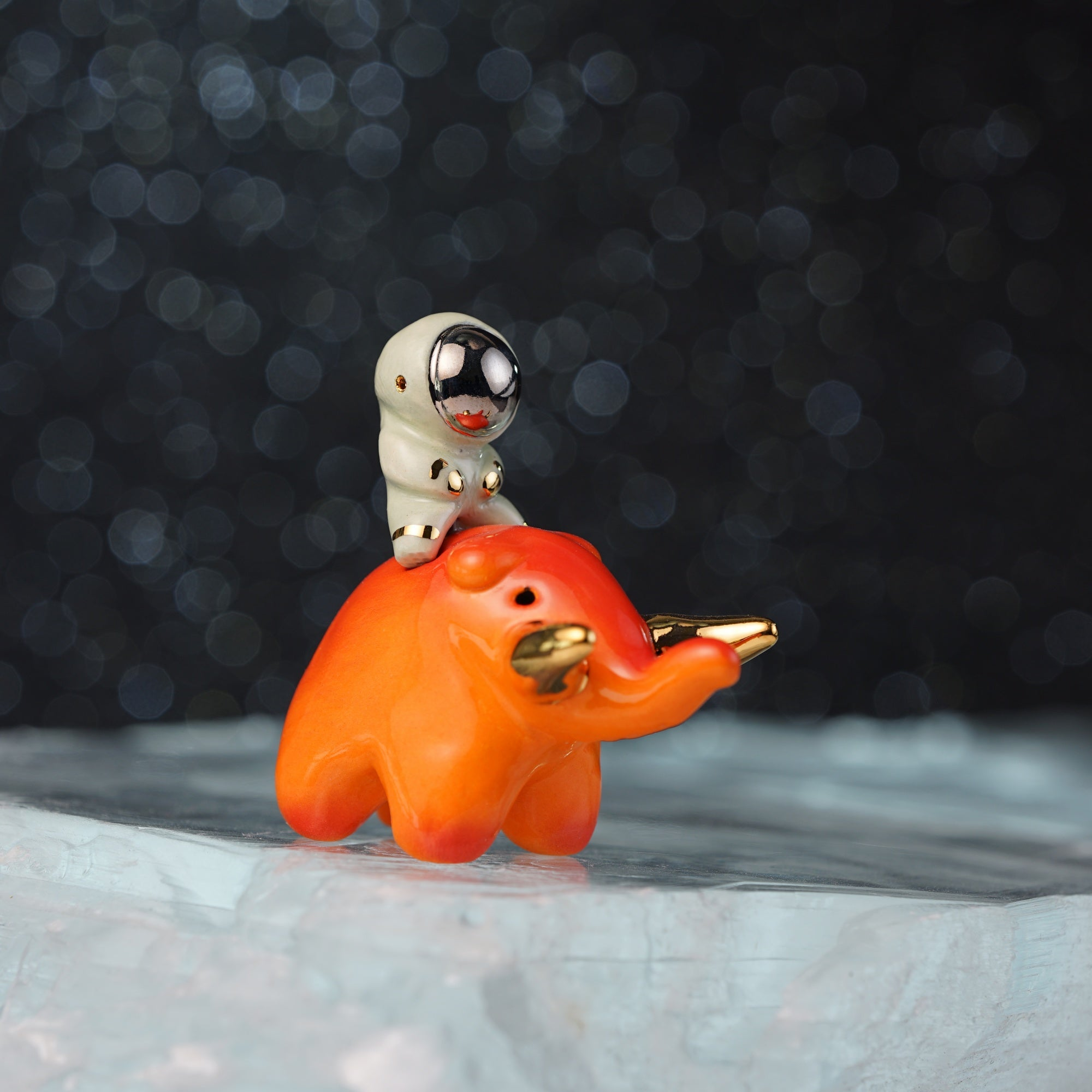 Astronaut Riding Mastodon Figurine