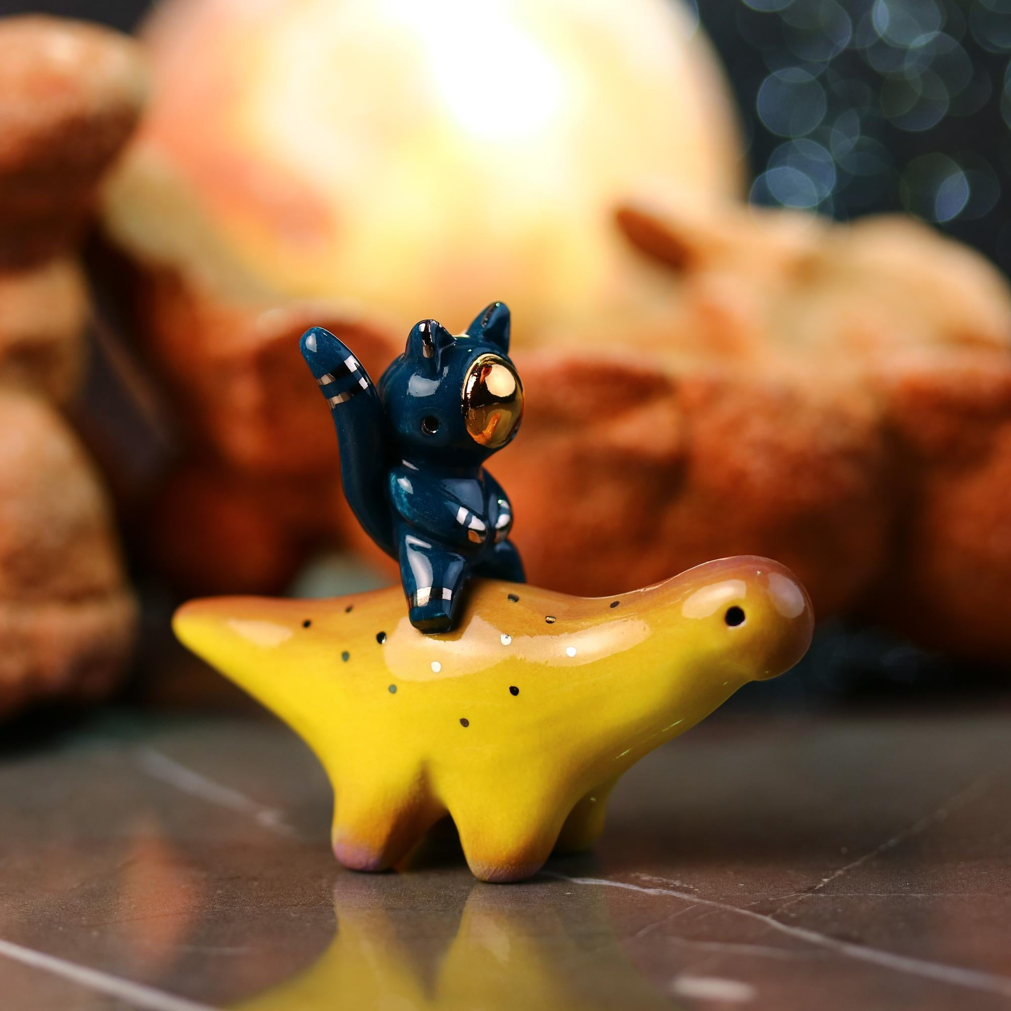 Catronaut Riding Dinosaur Figurine