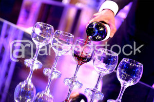 ID120 Pouring Grape Juice - Artandstock