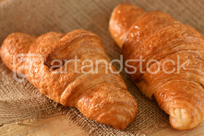 ID 149 Croissant on wood and jute texture - Artandstock