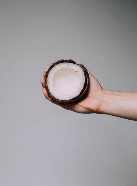 coconut being held