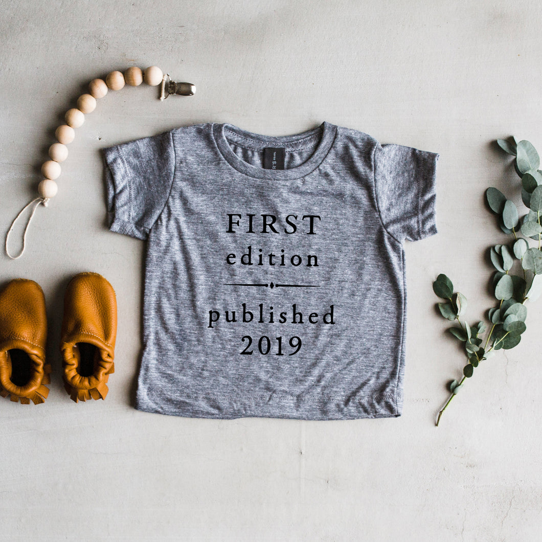First Edition Book Style Baby Tee
