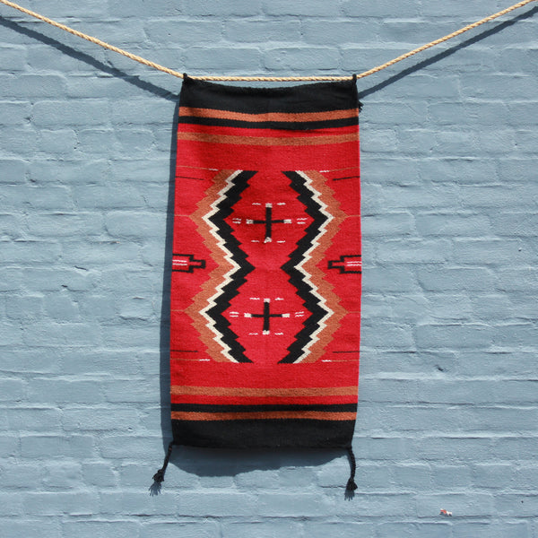 Hand woven wool Southwest print rug in red and black from High Desert Dry Goods