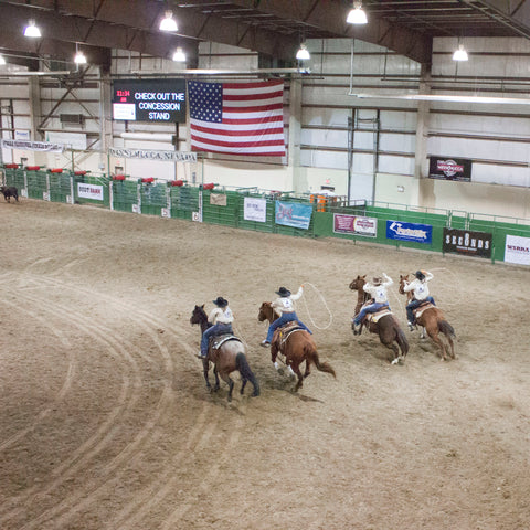 A team of female ropers at the Winnemucca Ranch Rodeo Finals