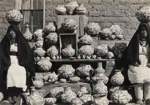 historic photo of Acoma Pueblo potters and their wares