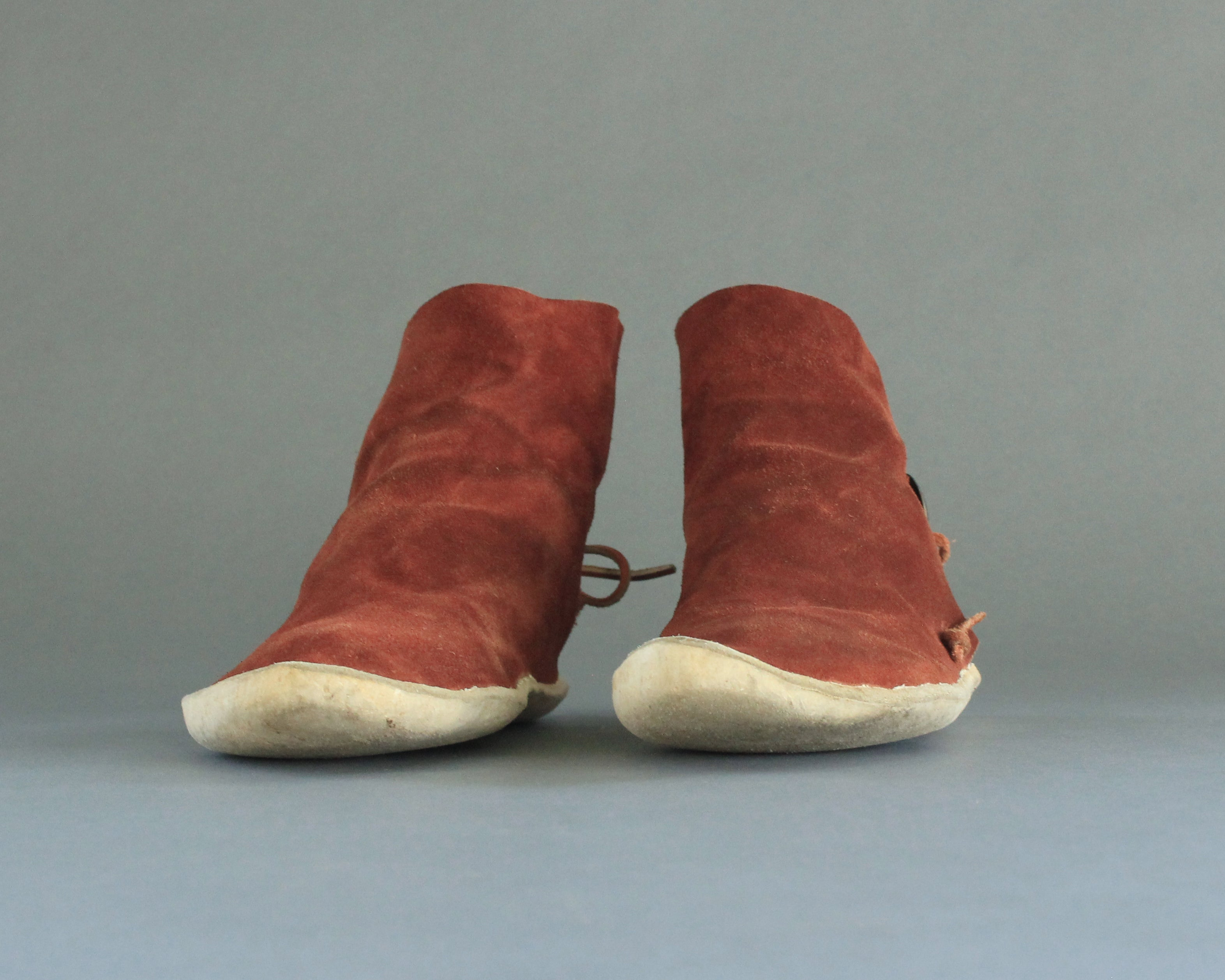 vintage high top moccasins with rawhide sole