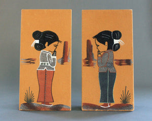 Navajo sand paintings of a boy and a girl by Sadie Akee