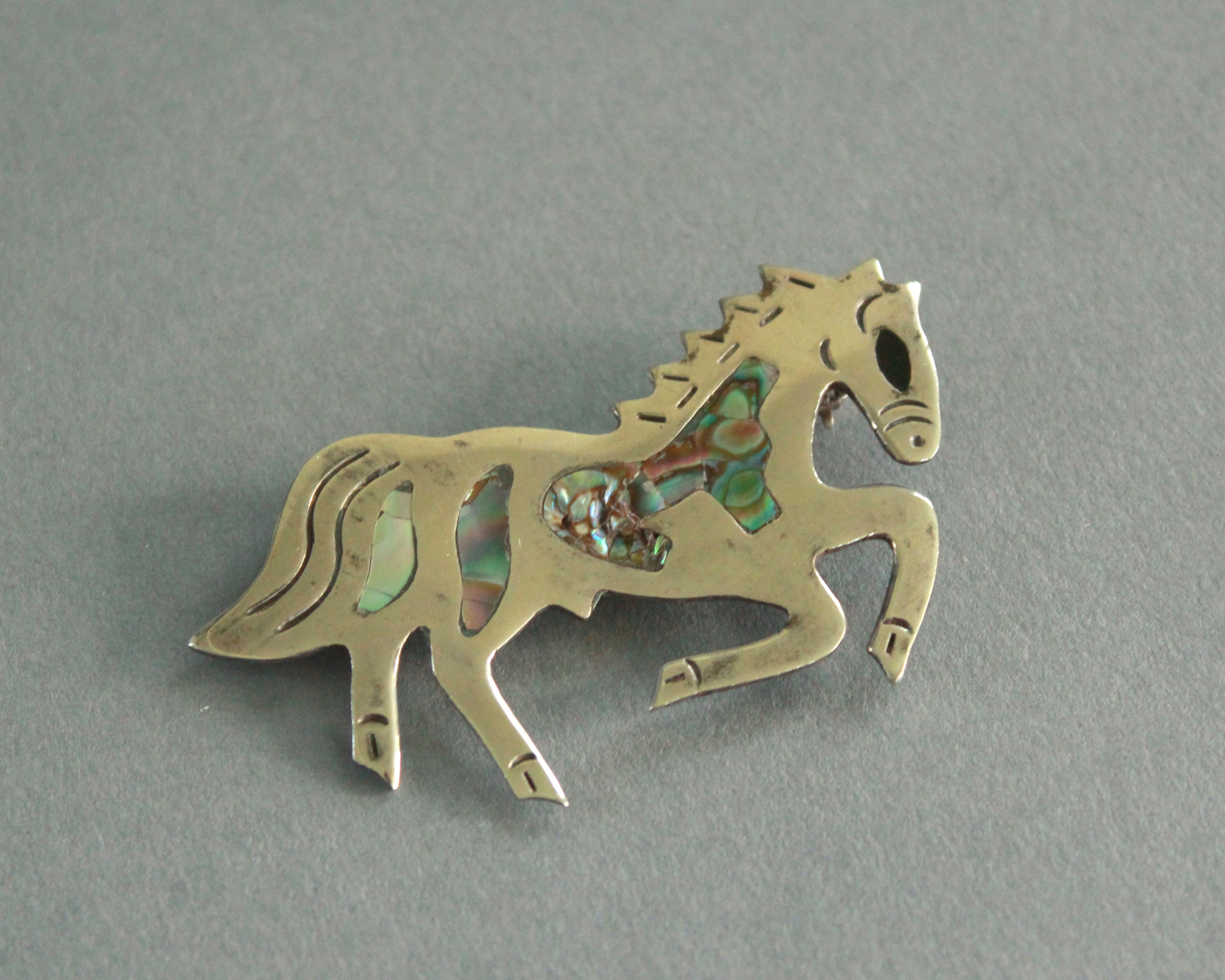 rearing horse abalone brooch