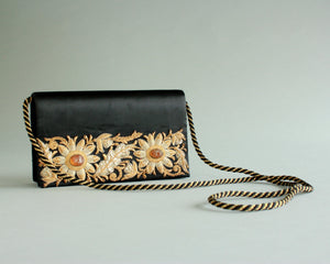Black satin evening bag with gold beading