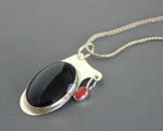 signed modern sterling silver and black pendant