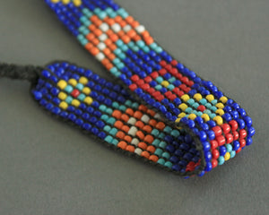 Beaded tribal bracelet or anklet in blue and orange