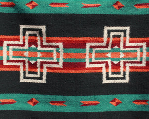 Green and black Southwest print wool rug with white crosses