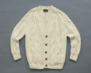 Irish wool cable knit cardigan with deep v neck and brown buttons