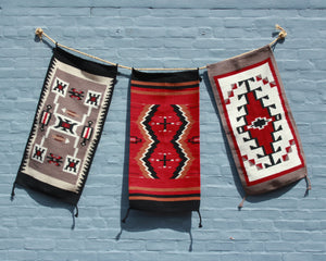 Hand woven wool doormats in geometric Southwest inspired prints