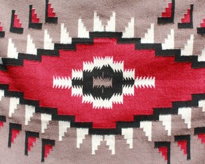 Southwest hawkeye print rug in tan, black and red wool