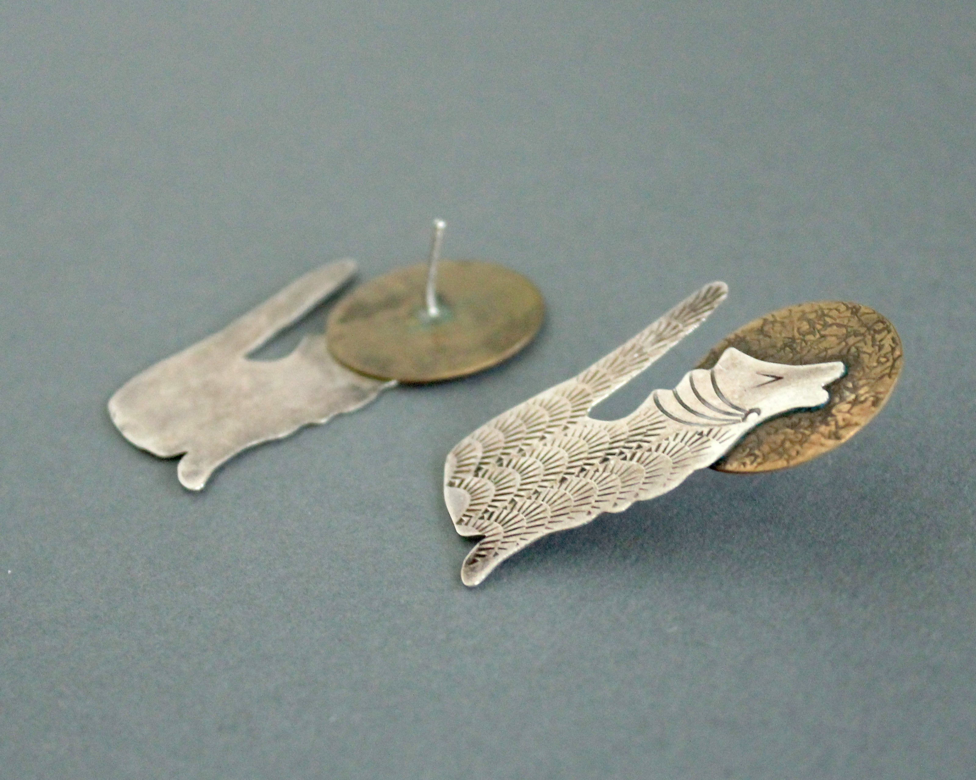 coyote howling at the moon earrings in silver and brass