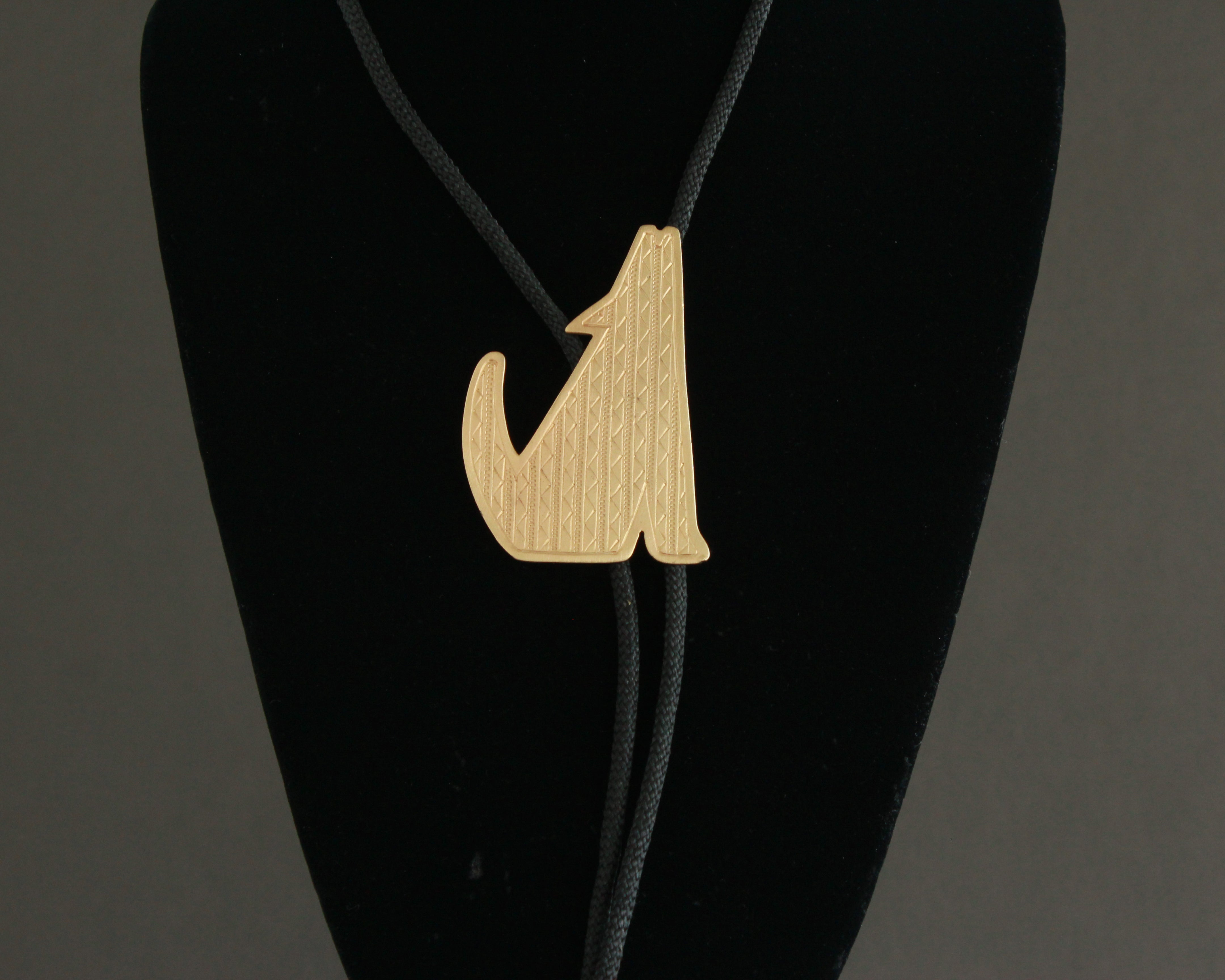 gold howling coyote 80s bolo tie