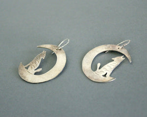 crescent moon and howling wolf earrings