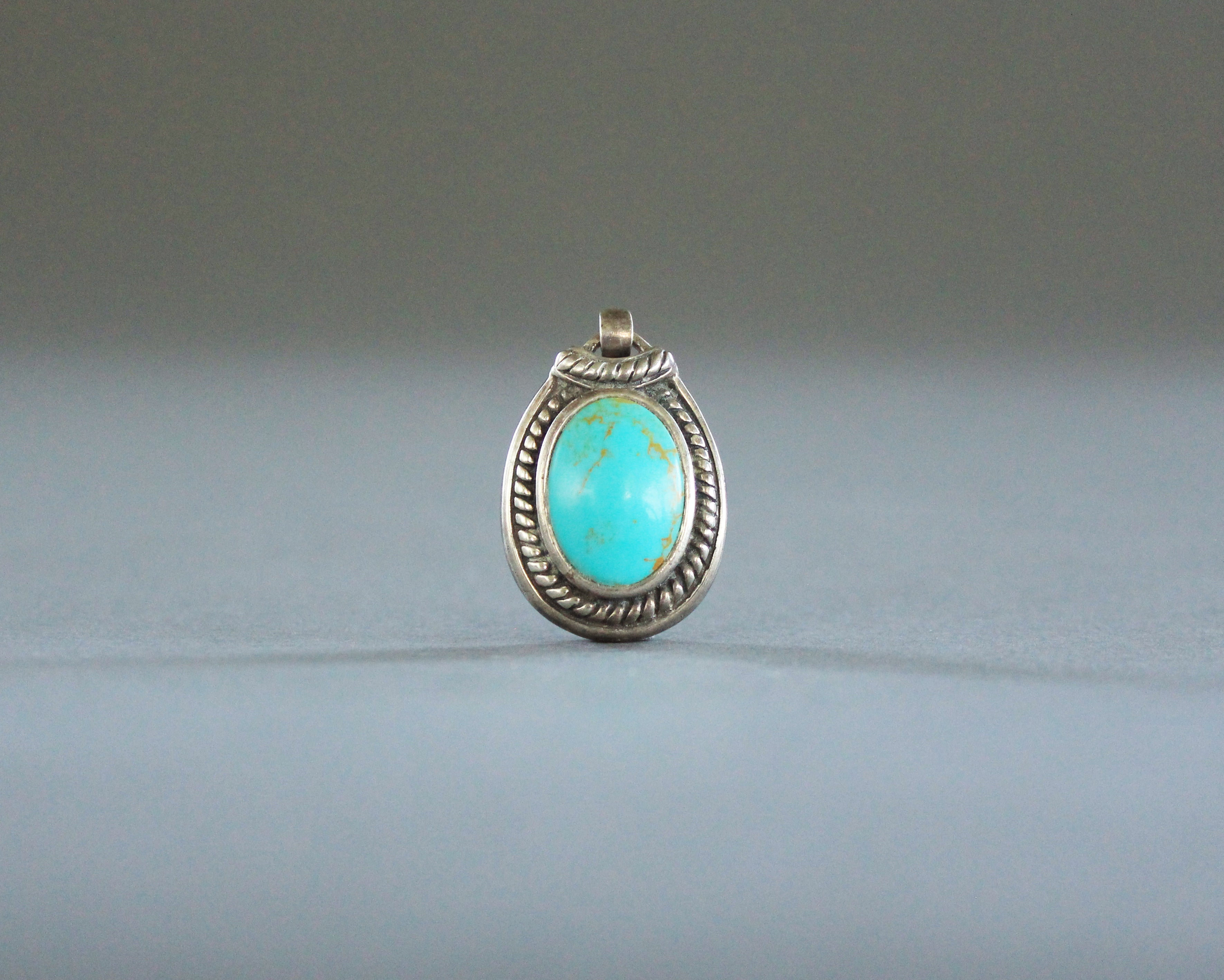 affordable sterling silver and turquoise colored pendant