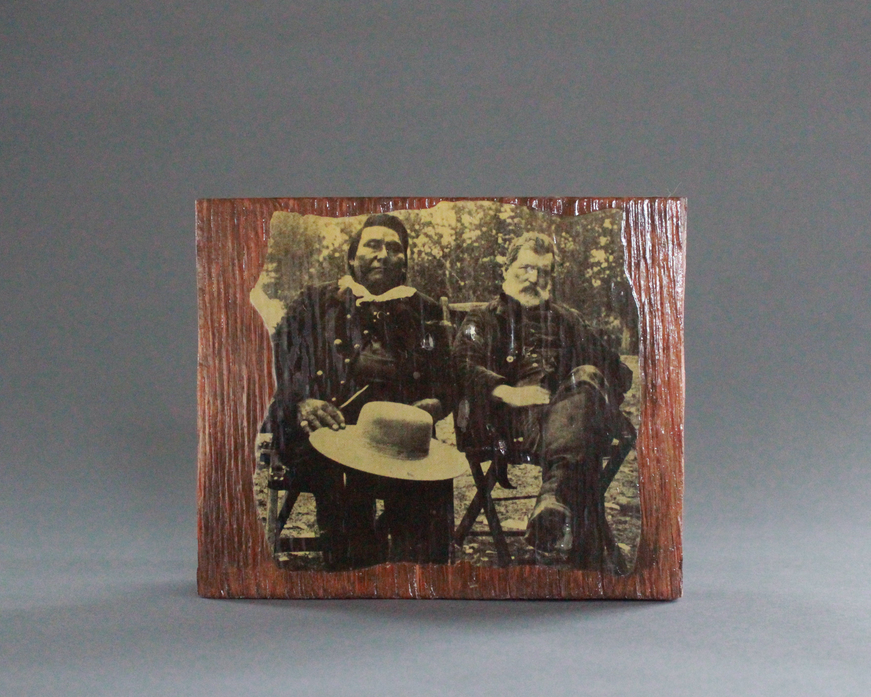 indian and soldier vintage photograph on wood