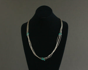 vintage 5 strand liquid silver necklace with turquoise nuggets