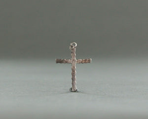 silver cross pendant with green stone