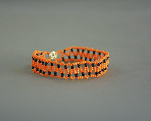 Handmade vintage orange and black beaded bracelet or anklet