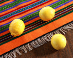 Handwoven Mexican table runner in orange stripe