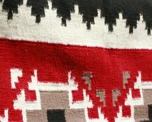 Large Southwest print wool area rug in red and black