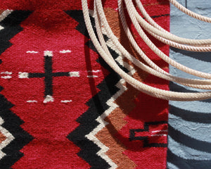 Southwest cross print wool accent rug in red and black
