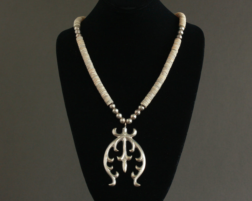 sand cast naja necklace with shells and silver beads