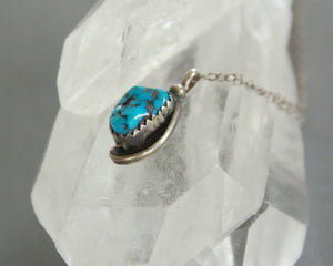 small Navajo signed turquoise silver pendant